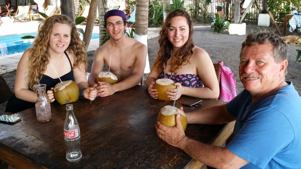 Work with Us. Family vacation drinking coconut milk on the Pacific Coast of Central America. DiscoverCreateInspire.com